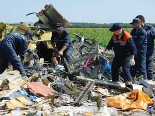 Ukrainian emergency workers dismantle the wreckage at the crash site of Malaysia Airlines Flight 17 near the village of Hrabove, eastern Ukraine, Sunday, July 20, 2014. Rebels in eastern Ukraine took control Sunday of the bodies recovered from downed Malaysia Airlines Flight 17, and the U.S. and European leaders demanded that Russian President Vladimir Putin make sure rebels give international investigators full access to the crash site.(AP Photo/Evgeniy Maloletka)