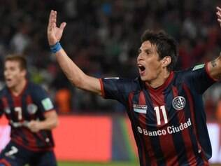San Lorenzo's midfielder Pablo Barrientos celebrates his goal during the FIFA Club World Cup semifinal football match San Lorenzo vs Auckland City FC at the Marrakesh stadium in the Moroccan city of Marrakesh on December 17, 2014. AFP PHOTO/ FADEL SENNA