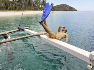 Em uma das pausas entre El Nido e Coron, mergulho no mar azul-turquesa
