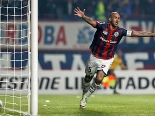 Juan Mercier of Argentina's San Lorenzo celebrates after scoring against Bolivia's Bolivar during a Copa Libertadores semifinals first-leg soccer match in Buenos Aires, Argentina, Wednesday, July 23, 2014. (AP Photo/Natacha Pisarenko)