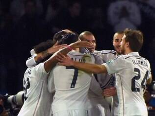 Real Madrid's players celebrate after defender Sergio Ramos scored a goal during the FIFA World Club Cup semi-final football match Real Madrid against Mexico's Cruz Azul FC at the Marrakesh Stadium on December 16, 2014 in Marrakesh.  AFP PHOTO / FADEL SENNA