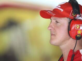Seven times Formula One World Champion Michael Schumacher looks information monitor during the first practice session in Sepang racetrack, outside Kuala Lumpur, Malaysia, Friday, April 3, 2009. The 2009 Malaysian  Formula One Grand Prix will be held here Sunday, April 5, 2009. (AP Photo/Eugene Hoshiko)