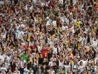 German fans celebrate during the World Cup final soccer match between Germany and Argentina at the Maracana Stadium in Rio de Janeiro, Brazil, Sunday, July 13, 2014. (AP Photo/Francois Xavier Marit, Pool)