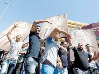 Manifestação. Iraquianos mostraram ontem seu apoio ao premiê Nuri al-Mailiki, que será substituído