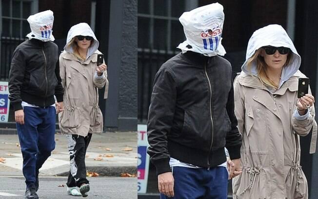 Matt Bellamy e Kate Hudson tentam se esconder de paparazzo em Londres