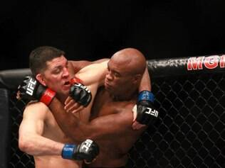 LAS VEGAS, NV - JANUARY 31: Nick Diaz and Anderson Silva fight in their middleweight bout during UFC 183 at the MGM Grand Garden Arena on January 31, 2015 in Las Vegas, Nevada. Silva won by unanimous decision.   Steve Marcus/Getty Images/AFP
