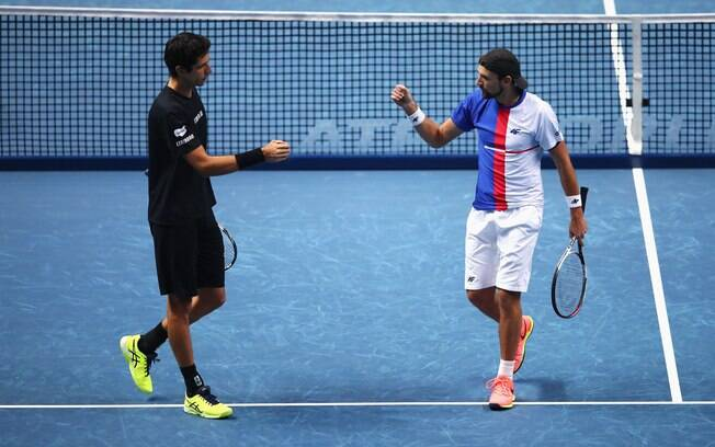 Dupla Marcelo Melo e Lukasz Kubot conquista vitória de número 50 na temporada e já está nas semifinais do ATP Finals