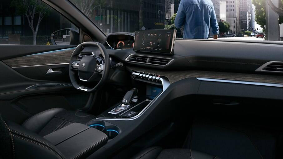 O interior do Peugeot 3008 traz inspirações de 'teclas de piano' nos botões do painel, iluminado por filete de luz