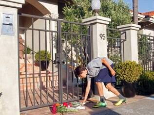 A boy leaves flowers at the home of Robin Williams, Monday, Aug. 11, 2014, in Tiburon, Calif. Williams, a brilliant shapeshifter who could channel his frenetic energy into delightful comic characters like