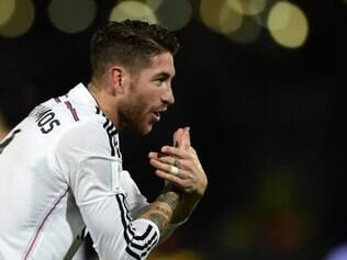 Real Madrid's defender Sergio Ramos celebrates after scoring a goal during the FIFA World Club Cup semi-final football match Real Madrid against Mexico's Cruz Azul FC at the Marrakesh Stadium on December 16, 2014 in Marrakesh.  AFP PHOTO / JAVIER SORIANO