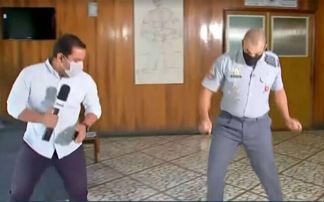 Repórter dança ao vivo com policial que viralizou