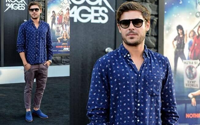 O ator Zac Efron usa camisa estampada no tapete vermelho. Foto  Getty Images 70d96b6e1cc1d