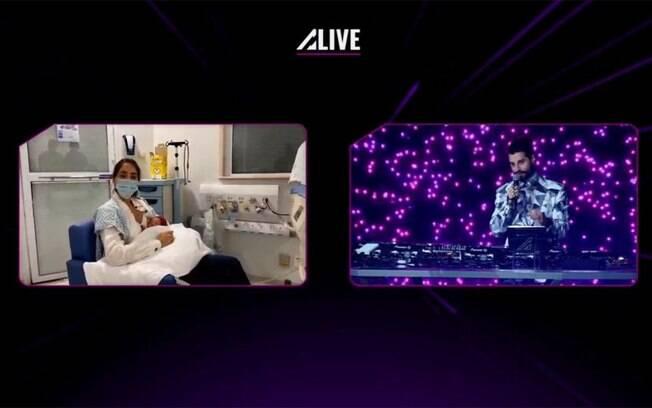 Alok faz um minuto de silêncio em live e liga para a esposa que estava no hospital
