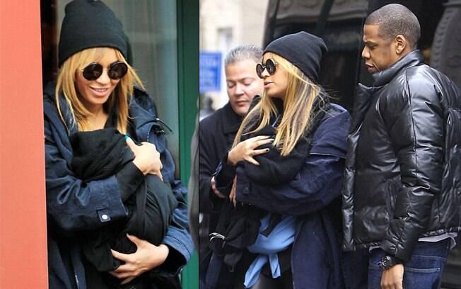 Beyoncé tentou esconder a filha dos paparazzi na entrada de um restaurante em Nova York nesse sábado (25)