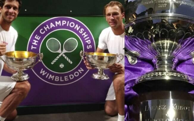 Marcelo Melo e Lukasz Kubot com troféu de campeões de duplas de Wimbledon