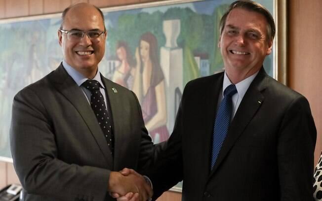 Bolsonaro e Witzel dando as mãos