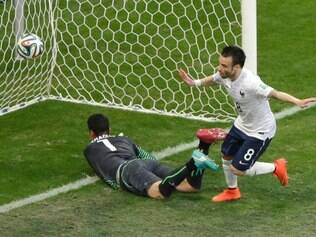 France's Mathieu Valbuena, right, celebrates scoring his side's third goal past Switzerland's goalkeeper Diego Benaglio during the group E World Cup soccer match between Switzerland and France at the Arena Fonte Nova in Salvador, Brazil, Friday, June 20, 2014. (AP Photo/Sergei Grits)