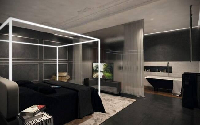 O quarto mantem a composição em cinza, preto e branco. A cabeceira da cama foi desenhada pelo arquiteto e um espelho fumê divide o espaço