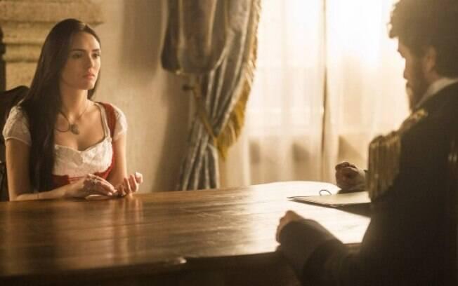 Anna implora que o ministro não deixe Vitória com Thomas.
