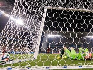 Russia's goalkeeper Igor Akinfeev covers his face after dropping the ball as South Korea's Lee Keun-ho scores the opening goal during the group H World Cup soccer match between Russia and South Korea at the Arena Pantanal in Cuiaba, Brazil, Tuesday, June 17, 2014. (AP Photo/Lee Jin-Man)