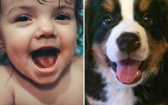 Menininha e cachorrinho rindo.