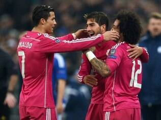 Real Madrid's Brazilian defender Marcelo (R) celebrates scoring with Real Madrid's Brazilian midfielder Lucas Silva (C) and Real Madrid's Portuguese forward Cristiano Ronaldo during the last sixteen, first-leg UEFA Champions League football match FC Schalke 04 vs Real Madrid in Gelsenkirchen, western Germany on February 18, 2015. AFP PHOTO / PATRIK STOLLARZ ta19011