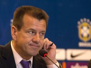 Brazil's soccer coach Dunga listens to a question during a press conference in Rio de Janeiro, Brazil, Tuesday, Aug. 19, 2014. Dunga summoned players for upcoming friendly games against Colombia and Ecuador, the first time he picked players since taking over the national team from Luiz Felipe Scolari after the World Cup. (AP Photo/Silvia Izquierdo)