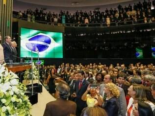 Handout picture released by the Brazilian presidency showing Brazil's President Dilma Rousseff (2-L) standing at the National Congress in Brasilia before taking the oath of office for her second term, on January 1, 2015. The 67-year-old left-wing former urban guerrilla begins her second term Thursday, aiming to get economic growth back on track, and to rebuild government credibility after a major kickbacks scandal. Rousseff, the 200 million-strong South American giant's first female leader, will first be driven in a Rolls Royce down the Ministries Esplanade to Congress, where she will take the oath before heading to the presidential palace to make a national address.  AFP PHOTO / PRESIDENCIA BRASIL / Roberto Stuckert Filho   ---  RESTRICTED TO EDITORIAL USE - MANDATORY CREDIT