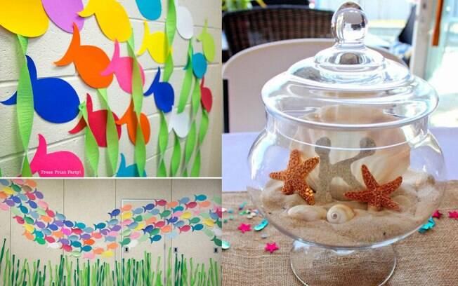 Caminho de peixes para indicar o local da festa e detalhes feitos com potinho de vidro, areia e conchas dão toque especial