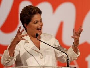 Brazil's President Dilma Rousseff, presidential candidate for re-election of the Workers Party, PT, talks about the results of the general elections during a press conference, in Brasilia, Brazil, Sunday, Oct. 5, 2014. Official results showed Sunday that President Dilma Rousseff will face challenger Aecio Neves, in a second-round vote in Brazil's most unpredictable presidential election since the nation's return to democracy nearly three decades ago. (AP Photo/Eraldo Peres)