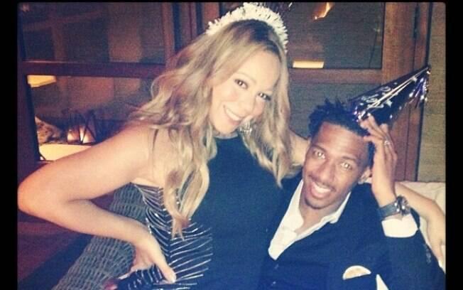 Mariah Carey publica foto no colo do marido, Nick Cannon, durante a comemoração dos 32 anos dele