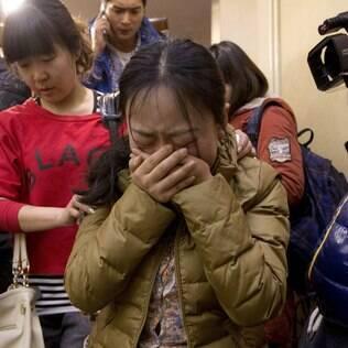 Familiares de passageiros do voo MH370: confirmação da queda acabou com esperanças de encontrar sobreviventes