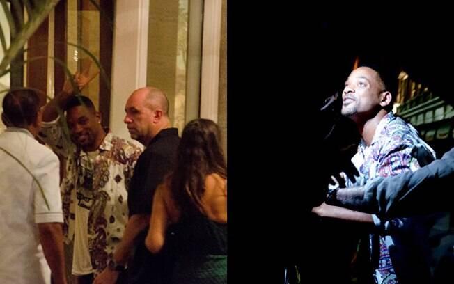 Will Smith acenou para os fotógrafos antes de entrar no hotel
