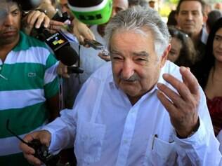 Uruguay's President Jose Mujica speaks to journalists after laying flowers at a monument of his nation's hero Jose Gervasio Artigas Arnal in Havana, Cuba, Thursday, July 25, 2013. (AP Photo/Franklin Reyes)