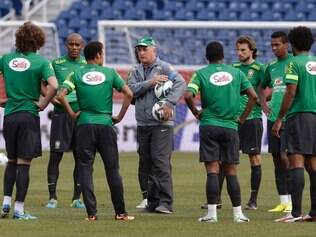 Luiz Felipe Scolari, head coach of Brazil's national soccer team, instructs members of his team during soccer practice in Foxborough, Mass., Monday, Sept. 9, 2013. Portugal will play team Brazil in a friendly match Tuesday. (AP Photo/Stephan Savoia)