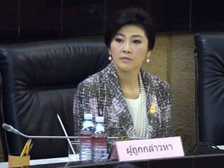 Ousted Thai prime minister Yingluck Shinawatra looks on as she faces impeachment proceedings by the military-stacked National Legislative Assembly (NLA) at the parliament in Bangkok on January 22, 2015. Shinawatra arrived at Thailand's junta-picked legislature on January 22 to make a last ditch defence ahead of an impeachment vote that could see her banned from politics for five years. AFP PHOTO / PORNCHAI KITTIWONGSAKUL