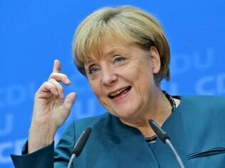 German Chancellor and chairwoman of the  Christian Democratic party, CDU, Angela Merkel,  raises a finger during a news conference after a  party's board meeting in Berlin, Monday, Sept. 23, 2013. German Chancellor Angela Merkel may have won an impressive third general election but she faces a delicate and lengthy task in forming a new government as party leaders met Monday to map out their next steps. Merkel's Union bloc achieved its best result in 23 years Sunday to put her on course for a third term, winning 41.5 percent of the vote and finishing only five seats short of an absolute majority in the lower house.  (AP Photo/Matthias Schrader)