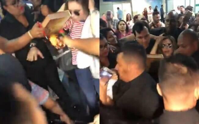 Sandy leva susto quando fã puxa a sua cabeça durante tumulto no aeroporto de Recife