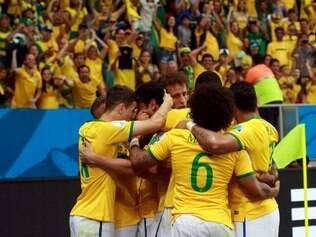 Brazilian squad players celebrate during rout 4-1 over Cameroon at Mané Garrincha stadium