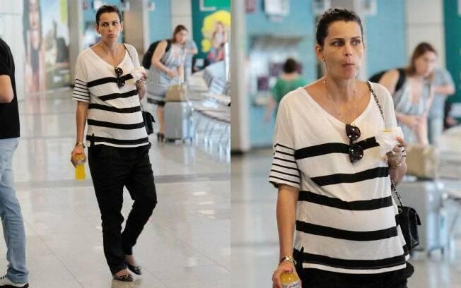 Fernanda Motta circula com barrigão em aeroporto