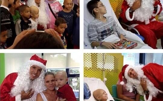 Luis Fabiano se veste de Papai Noel e visita crianças com câncer no Graacc - Futebol - iG