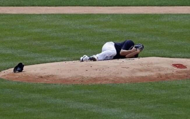 Tanaka caído no chão