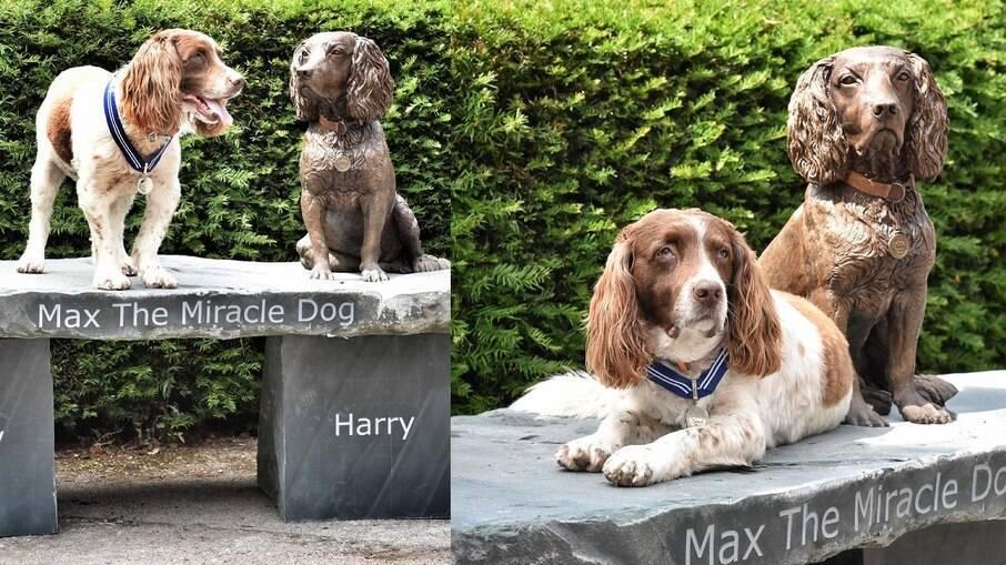Max ao lado da estátua em sua homenagem