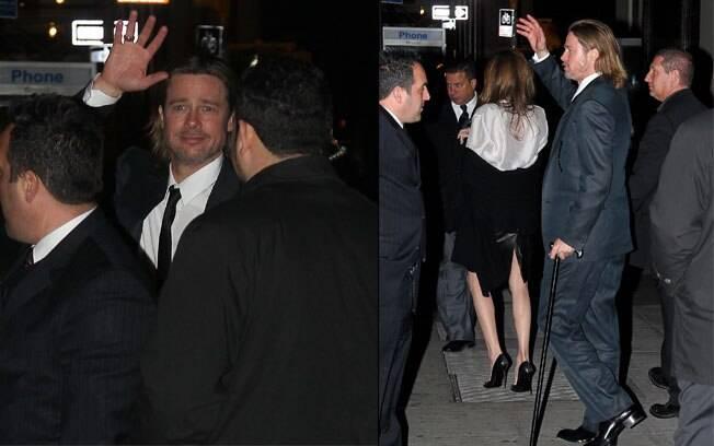 Mancando, Brad Pitt acena para os fãs na saída da premiação