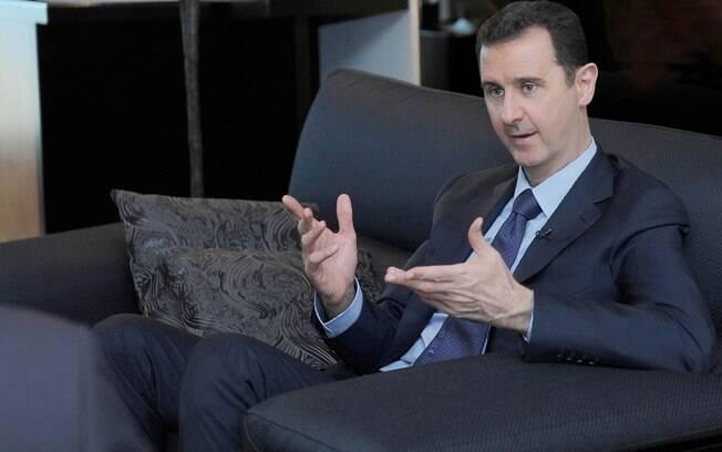 Assad alerta para risco de guerra regional se Síria for alvo de ataque militar