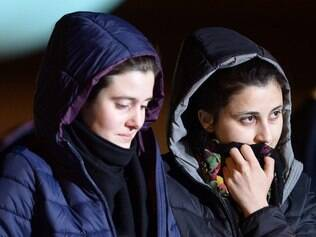 Italian aid workers abducted in Syria last summer, Greta Ramelli (L) and Vanessa Marzullo disembark from a plane early on January 16, 2015 at Ciampino airport in Rome after being freed yesterday. Officials did not release any further details of how the two young women had come to be freed by or from their unknown abductors.