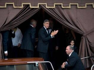 George Clooney on his way to marry Amal Alamuddin, in Venice, Italy, Saturday, Sept. 27, 2014. (AP Photo/Andrew Medichini)