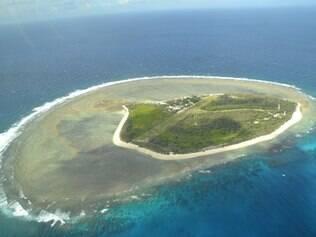 Vista aérea para uma porção da Grande Barreira de Corais, um destino imperdível para os amantes de mergulho