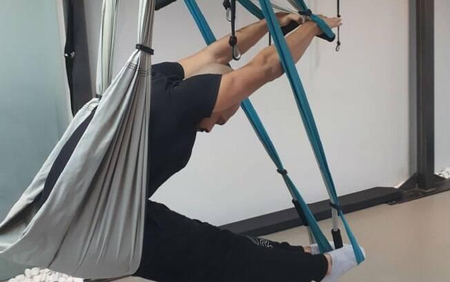 O pilates suspenso, ou funcional por suspensão, pode ser praticado no colúmpio (foto) ou nas fitas de suspensão