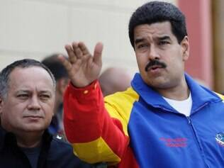 Venezuela's President Nicolas Maduro, right, gestures as National Assembly President Diosdado Cabello looks on during a ceremony marking the third month since President Hugo Chavez died, at the Military Museum where his remains rest in Caracas, Venezuela, Wednesday, June 5, 2013. Chavez died on March 5, 2013.  (AP Photo/Ariana Cubillos)